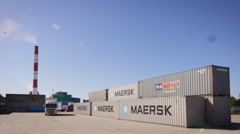 Container Handler is Loading Container onto Truck in Logistic Center Stock Footage