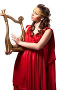 Beautiful young female wearing red dress antique style isolated on white Stock Photos