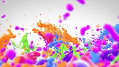 Colored paint splashing Stock Footage