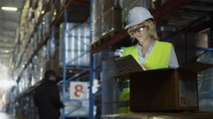 Female Manager of Logistics Warehouse is Working on Tablet PC. Stock Footage