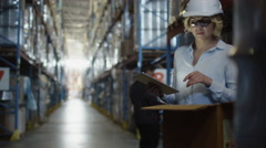 Female Manager of Logistics Warehouse is Working on Tablet PC Stock Footage