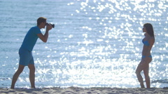 4 in 1 video! Photographer shoot woman on beach by bright sunlight sea backround Stock Footage