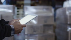 Worker of Logistic Warehouse is Holding Tablet PC in Hands Stock Footage