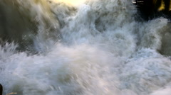 Raging clean fresh mountain river flowing between rocks in slow notion Stock Footage