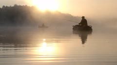 Fishing in the morning mist - stock footage