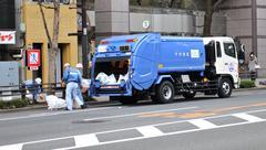 Garbage truck Stock Photos