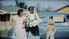1953: Mom reading paper helping baby and aunt walking. Stock Footage