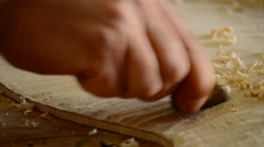 Luthier sanding a guitar with a little woodplaner Stock Footage