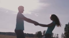 Beautiful Couple Holding Hands In Nature Stock Footage