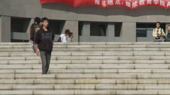 Young Chinese people walking down steps Stock Footage