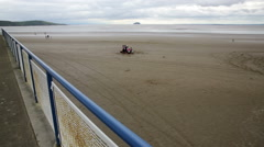 Weston Super Mare beach, railings cloudy summer day Stock Footage