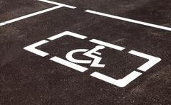 Parking places with handicapped or disabled signs and marking lines on asphal Stock Photos