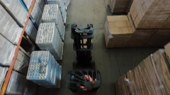 Aerial Overhead Shot of Working Forklift Loader inside Logistic Warehouse - stock footage