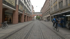 Riding bikes and driving on Theatinerstrasse, Munich Stock Footage