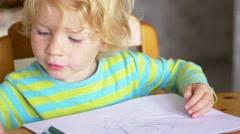 Little Boy Paints A Colorful Picture Stock Footage