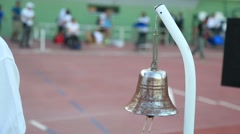 The olympic games. Official rings last lap bell during an athletics race Stock Footage