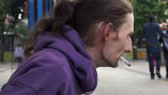Homeless smoking and asking charity: jobless in the street Stock Footage