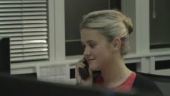 Receptionist Answering Phone - Dolly Shot - stock footage
