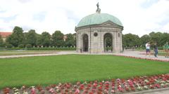 People walking in Hofgarten, near the Temple of Diana, Munich Stock Footage