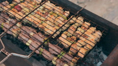 Mouthwatering different kinds of meat with grilled vegetables on a barbecue Stock Footage