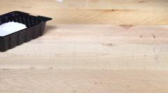 Painter brushing primer onto wood Stock Footage
