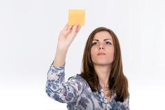 Young lady attaches sticker to the board Stock Photos