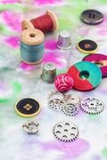 Threads and embellishments on a colorful background Stock Photos