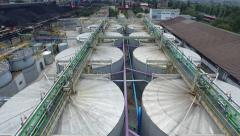 Huge iron tanks at the plant aerial Stock Footage