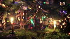 Wax Candle Detail as Traditional Light in Christmas Tree Decoration with Baubles - stock footage