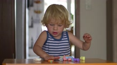 Boy Playing With Plasticine Stock Footage