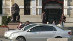Chinese people, traffic, lion statue, China Stock Footage