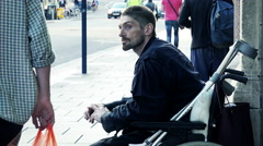 Homeless on wheelchair asking for charity: asking food, coins, change, aid Stock Footage