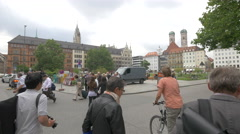 People walking on the street near Marienhof and resting in the park, Munich Stock Footage