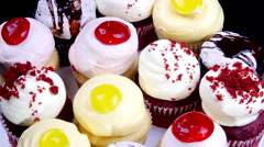 Delicious lemon, cherry and chocolate cupcakes Stock Footage
