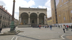 Tourists visiting, resting and taking pictures at Feldherrnhalle, Munich Stock Footage