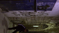 A boy juggling a soccer ball in an alley filmed in Stock Footage
