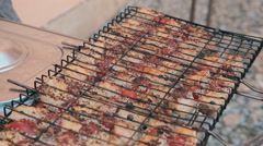 Roasted salmon slices and tomatoes in sesame removed from a grille Stock Footage