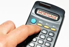 Mortgage word on calculator Stock Photos