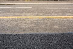 new and old asphalt road - stock photo