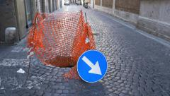 Stock Video Footage of Road sign and repair on cobblestone street. Rome, Italy.
