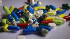 Medicine concept, multicolored pills and capsules falling down, slow motion. Stock Footage