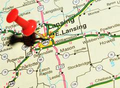 Lansing marked with red pushpin on the map - stock photo