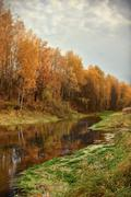 Mellow autumn on river bank Stock Photos