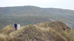 The bride and groom are on the mountain - stock footage