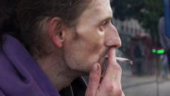 Homeless smoking: asking for charity, waiting for the aid of people: asking food Stock Footage