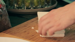 The process of cutting the feta cheese into cubes by chef Stock Footage