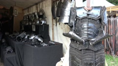 4k Knight's armor selling shop at medieval pageant event Stock Footage