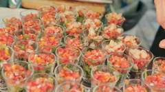 Portions with salad of vegetables and fish on a tray in the catering Stock Footage