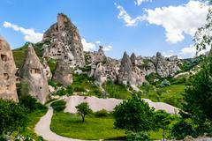 Natural fortress of Uchisar, riddled with man-made dwellings and dovecotes, d - stock photo