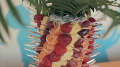 Pyramid of juicy fruits on a banquet Stock Footage